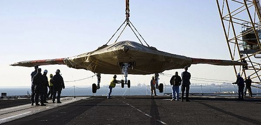X-47B_being_unloaded_aboard_USS_Harry_S._Truman._Photo_US_Navy.jpeg