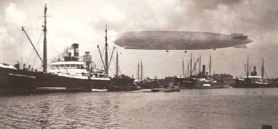 Passenger Airship Graf Zeppelin flying over the port of Amsterdam in October 1929, a photo hanging on the wall of Rudy Puister in Spain.