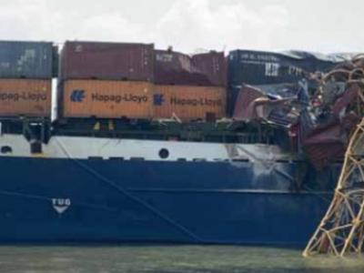 Vietnamese boxship loses power, slams into crane